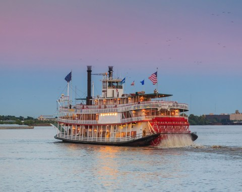 Photo of the MIssissippi Creole Queen at sunset on the Mississippi River