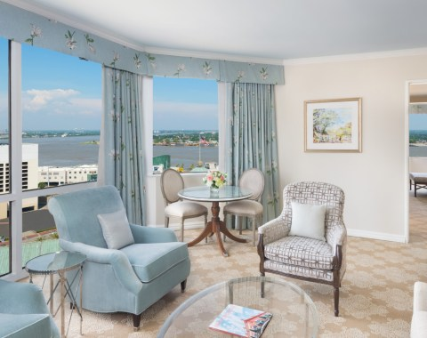 View of the living area of a Premium Suite, including elegant furniture and sweeping views of the Mississippi River