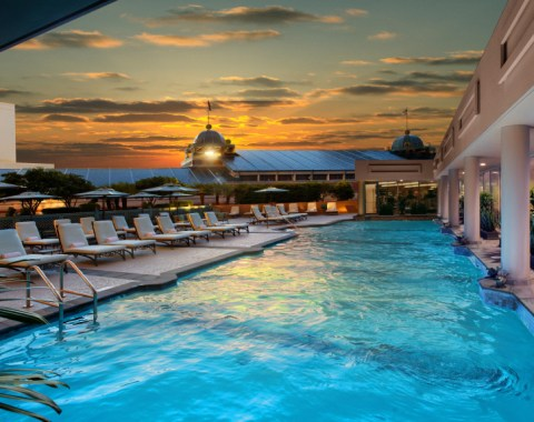 Sunset view of the rooftop pool and lounge chairs at the Windsor Court Hotel in New Orleans