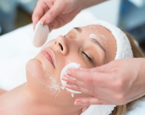 a facial being performed on a woman's face