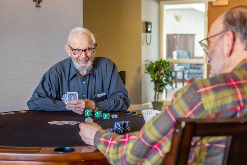 senior men playing poker
