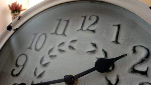 Close up image of a clock face.