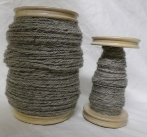 Gray wool: 3-ply on the large bobbin, 2-ply on the smaller one.