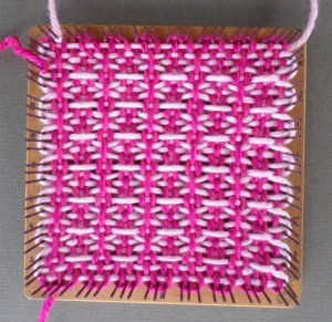 The finished square still on the loom. Note how color one is tied near Cr3.