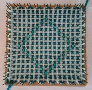 Finished square on the loom.