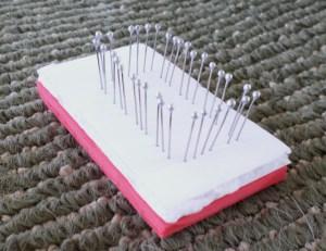 "A true ""pin"" loom, made with dressmakers pins, foam core, and fun foam."
