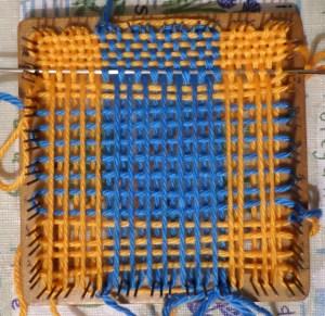 Weaving in progress.