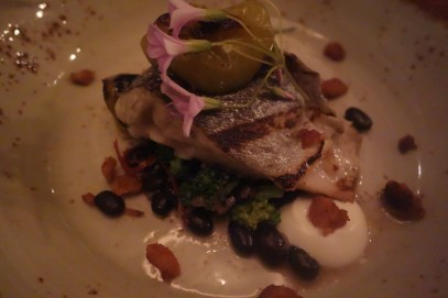 One of the two main dishes included: Grilled Rushing Waters Rainbow Trout, Black Garlic Roasted Tomatillos, Black Bean Relish, Swan Creek Bacon Lardon. Photo: Amanda Elliott
