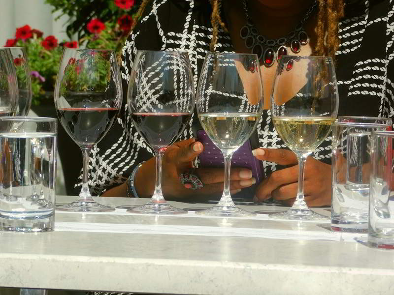 A Flight of Four Wine Tasting Glasses