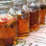 homemade DIY infused whiskey bourbon gift sets including lemon-ginger whiskey, vanilla whiskey, coffee whiskey and apple cinnamon whiskey
