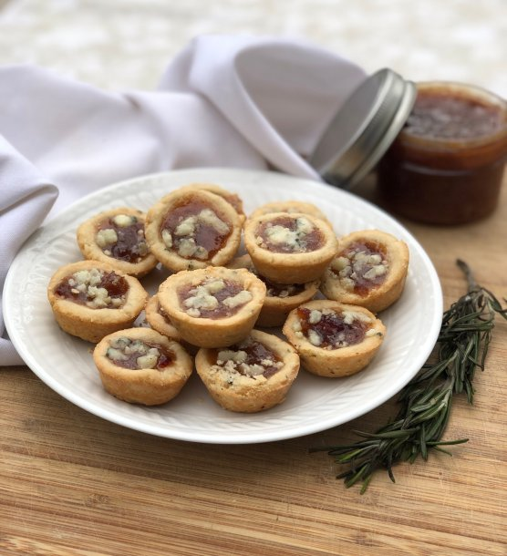 Savory mini tart with rosemary shortbread and filled with homemade jam perfect for holiday appetizers