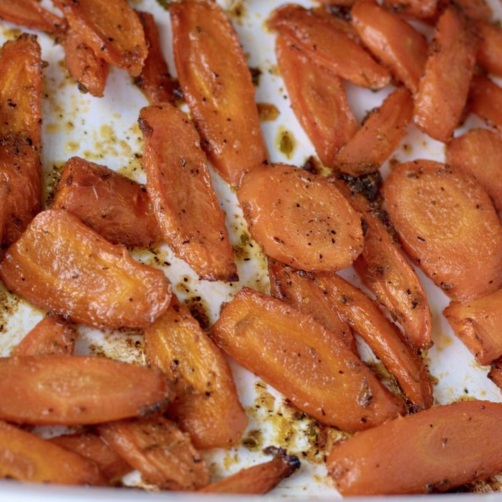 Roasted carrots with lemon maple and thyme are cooked in the oven until soft and caramelized. They're made with thyme and garlic.