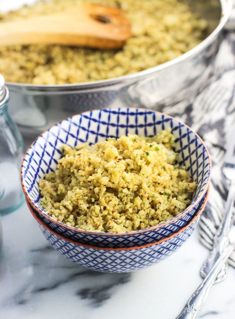 Parmesan pesto cauliflower rice is a quick, healthy side dish flavored with Parmesan cheese and pesto sauce. It's a low carb side dish that's deliciously tasty!