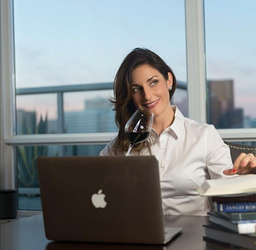 Women in wine: Laura Donadoni at her desk smelling wine