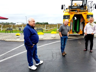 Standing in front of a grape harvester, Tomasello Winery co-owners  and brothers (L-R) Charlie & Jack Tomasello, describe the 50 wines produced at the winery from 30 grape varieties.  Wine Casual