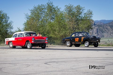 A red and black car in the burnout box at the Osoyoos drag races