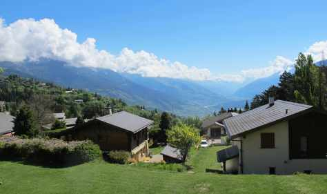 Azure blue skies and lush green landscapes with a view up the Rhone River Valley from Chalet Petite Tara on a late spring day.