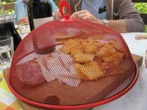 Antipasti including salami, lardo and frittata.