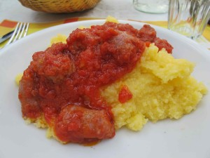 Salsiccia on polenta served with fresh creamy butter and Gorgonzola.