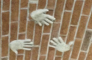 Handprints of the three Grasso sisters of Ca' del Baio - Paola, Valentina and Federica - on the roof of the newest addition to the winery.