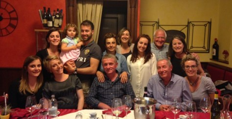 My husband Dani and me (right, back row) enjoying a great evening with our two adopted families - Grasso and Deltetto.