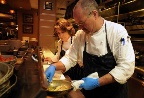 Chef Paul Wade showing Suzanne the finer points of making Toscanini's gnocchi with wild boar belly. Photo by Kristin Anderson