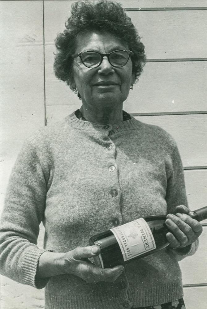Grandma Romilda Rotta holding a bottle of Rotta Zinfandel Rosé.
