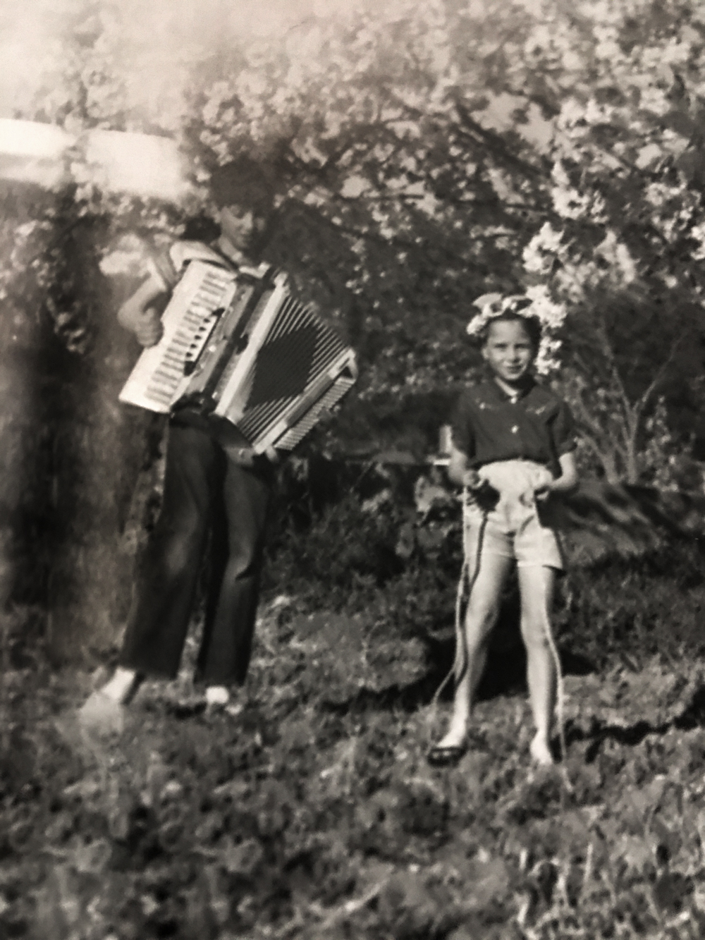 Bruno Martinelli playing the accordian with younger sister Silvana Martinelli.