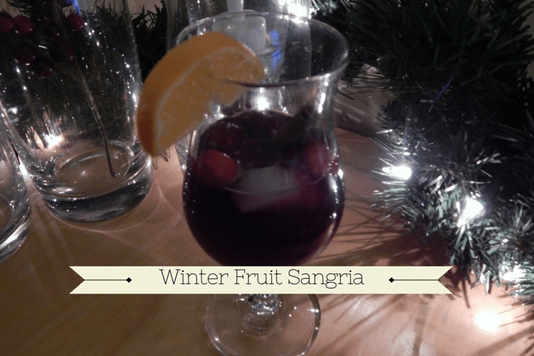 Winter Fruit Sangria with cranberries and clementines is the perfect drink for winter festivities.