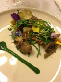 Surf and Turf Salad- Fried Chicken Skins, Sea Beans, Nasturtium, Pansies, petit onions, root greens, Romaine Puree, Spring Green Pea Gazpacho, Morels, Fiddlehead Ferns, Poached Baby Potatoes, Shaved Chorizo - close up