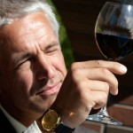 Portrait of man observing color in wine