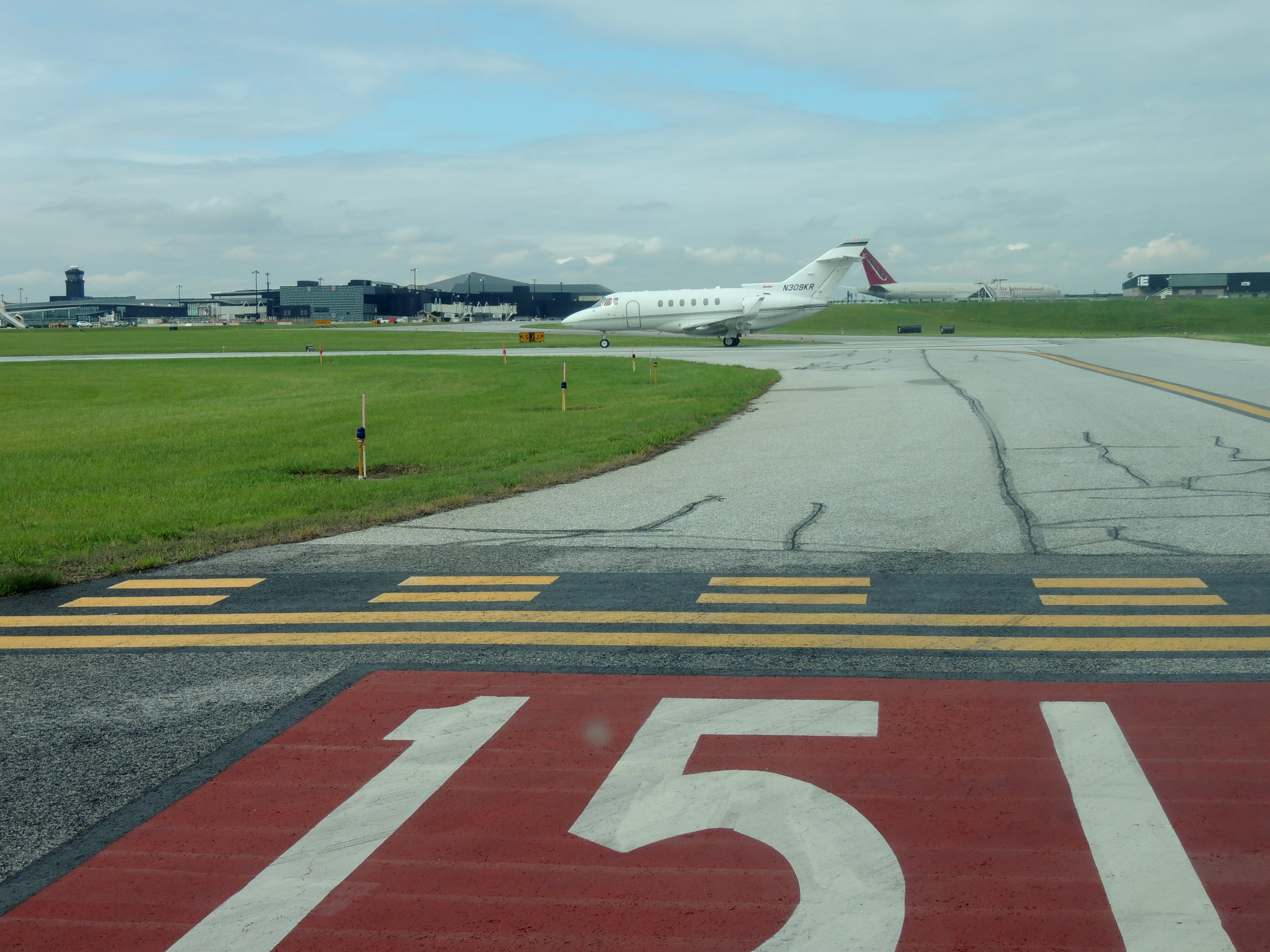 Waiting our turn to depart BWI on runway 15L..... behind a Hawker