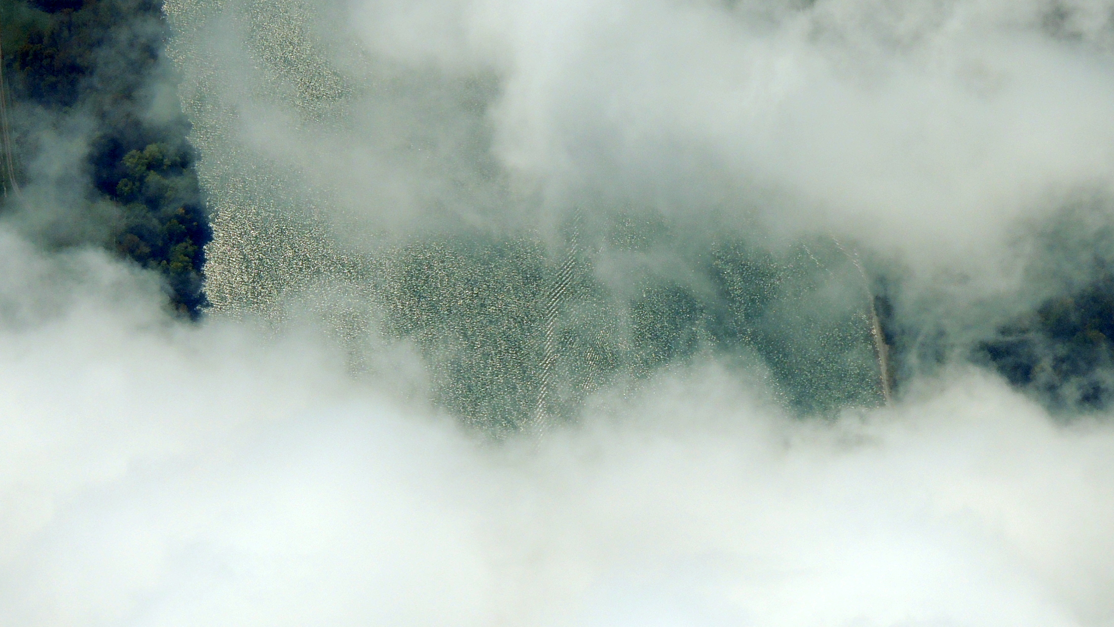 Looking straight down thru the clouds at the Mighty Ohio River