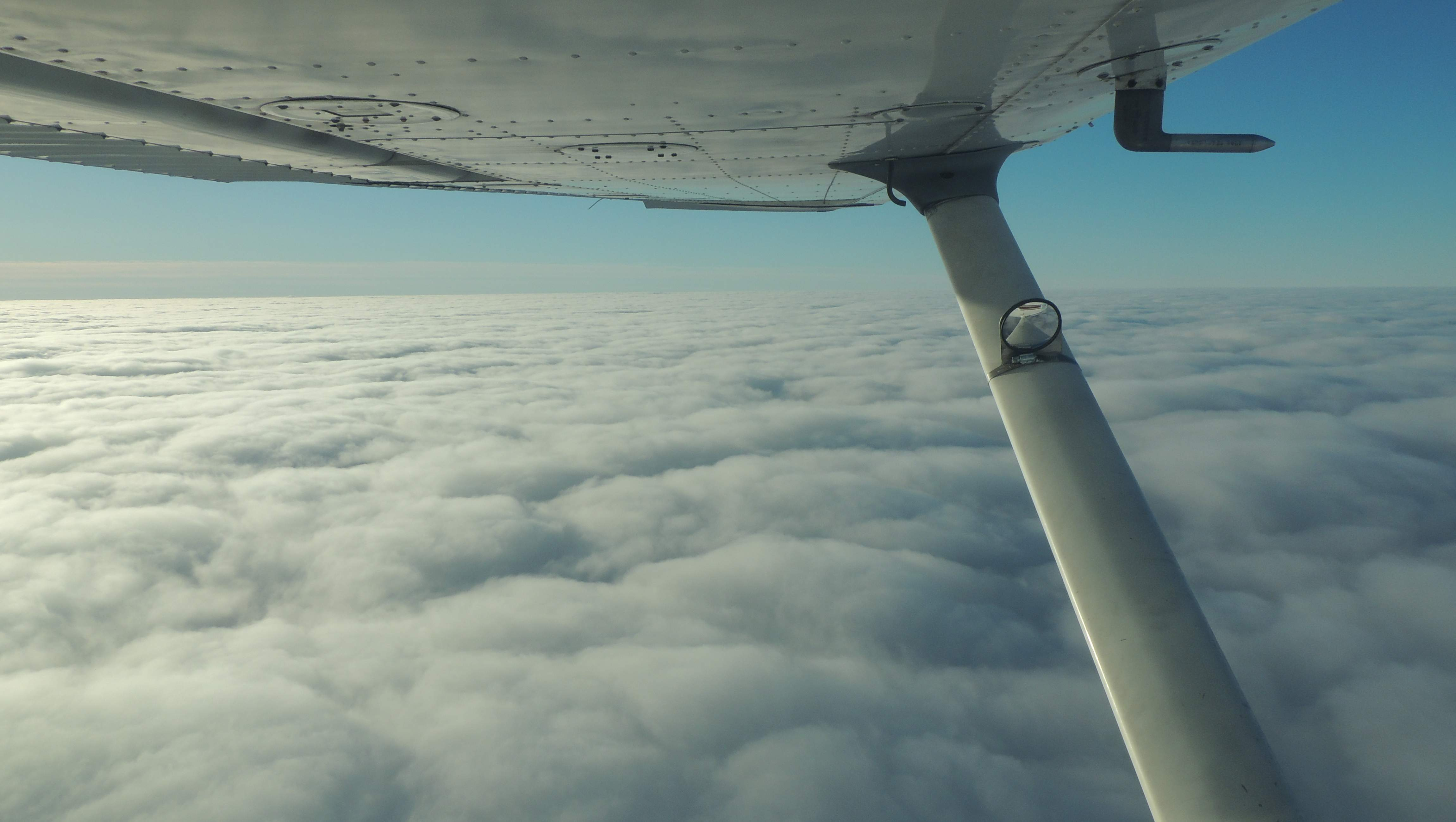 7000 feet and above the clouds over West Virginia    (It is snowing down below)