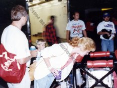 Fans look closely at an ISMA supermodified at 1994 Indianapolis Raceway Park exhibition
