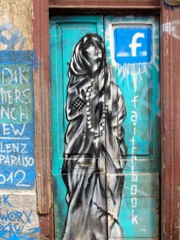 "Street art in Valaparaiso, Chile. ""Faithbook"" or Facebook."
