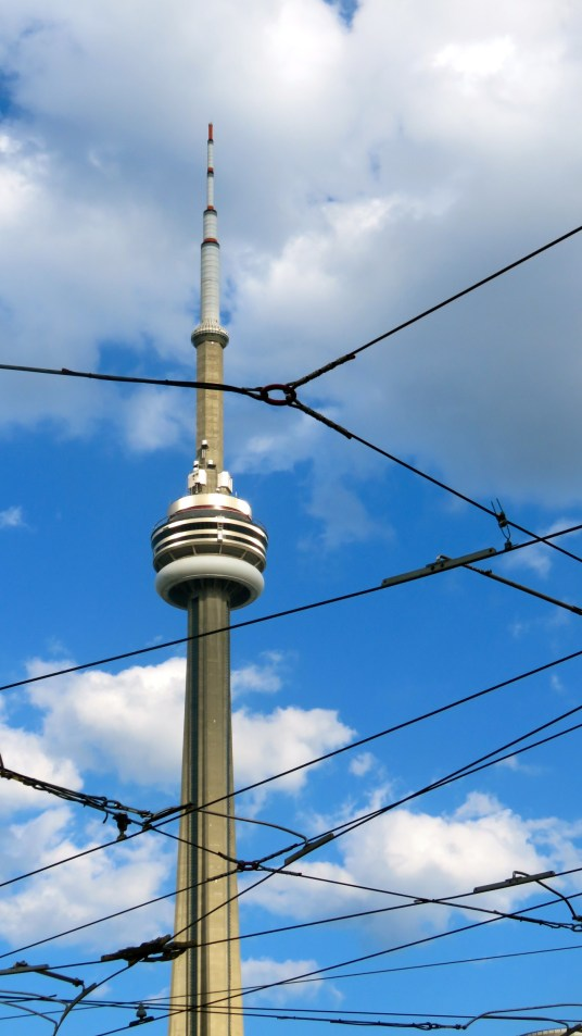 CN Tower amongst Toronto street car wires