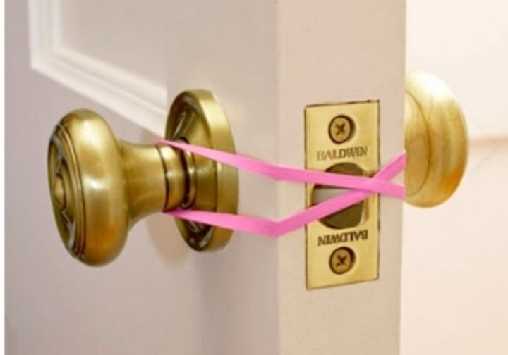 24 Life Hacks for Kids - Prevent kids from locking the door accidentally by using a simple rubber band.