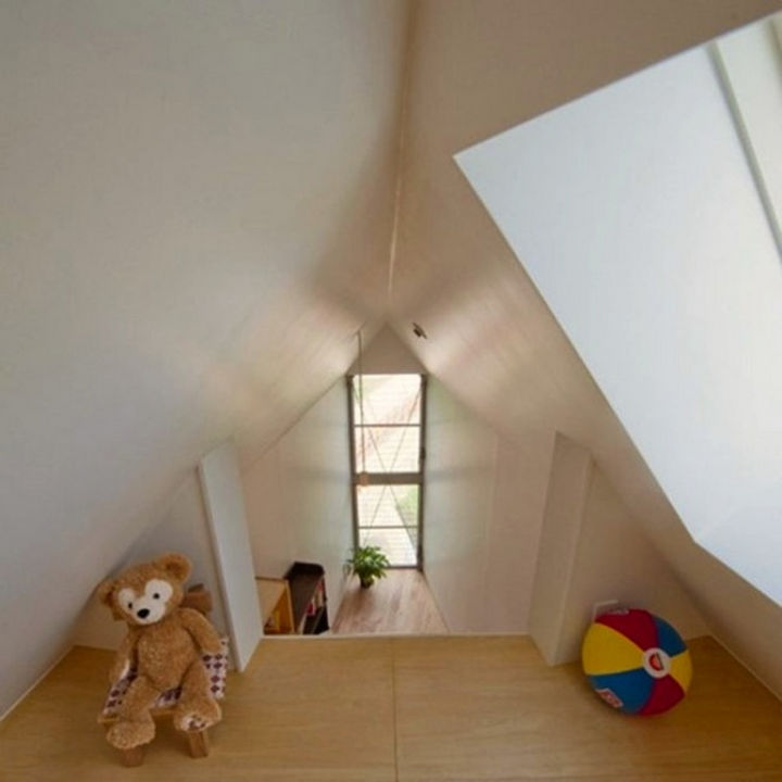 Small House Design in Japan - The loft features high vaulted ceilings which creates a sense of space.