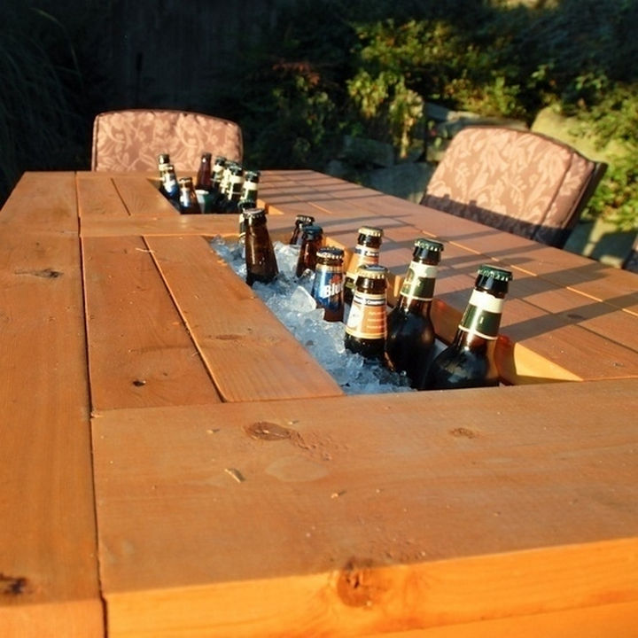 34 DIY Backyard Ideas for the Summer - Create a patio table with a built-in beer and wine cooler.