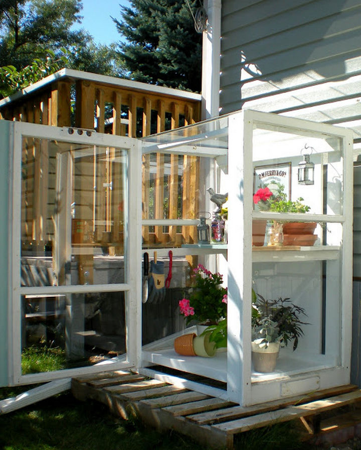 34 DIY Backyard Ideas for the Summer - Build a personal greenhouse by reusing old storm windows.