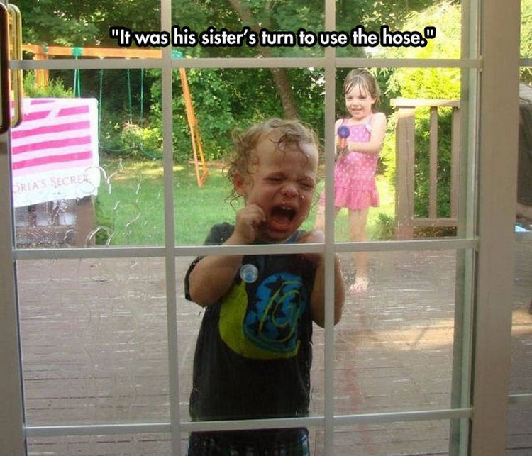37 Photos of Kids Losing It - It was his sister's turn to use the hose.