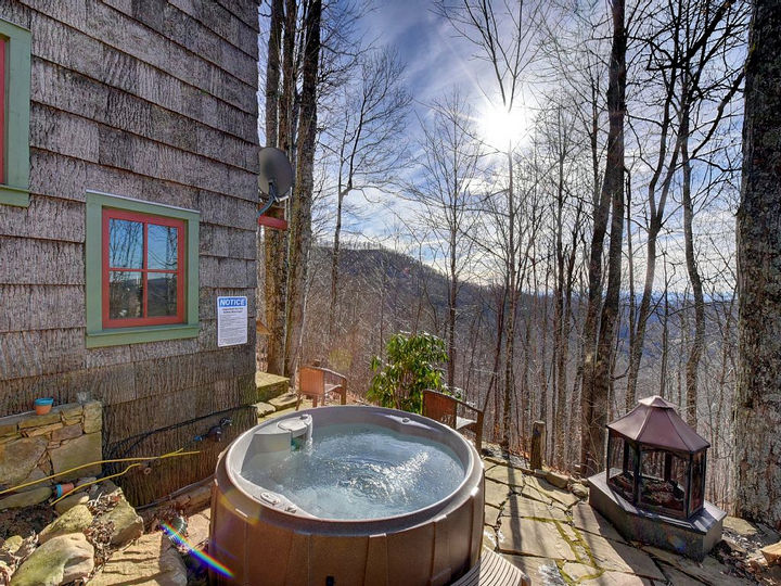 It has modern amenities like this gorgeous hot tub for outdoor entertaining.