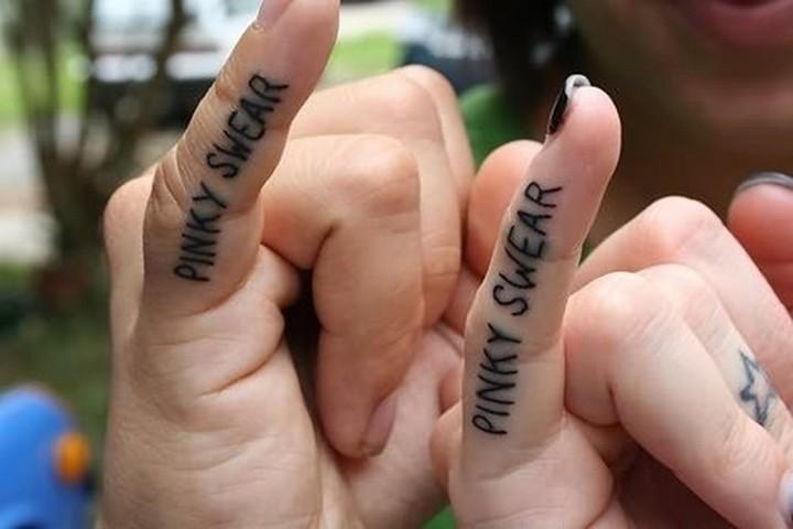 35 couple tattoos - Pinky swear couple tattoos.