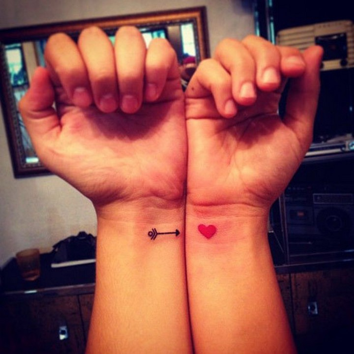 35 couple tattoos - Cupid's arrow couple tattoos.