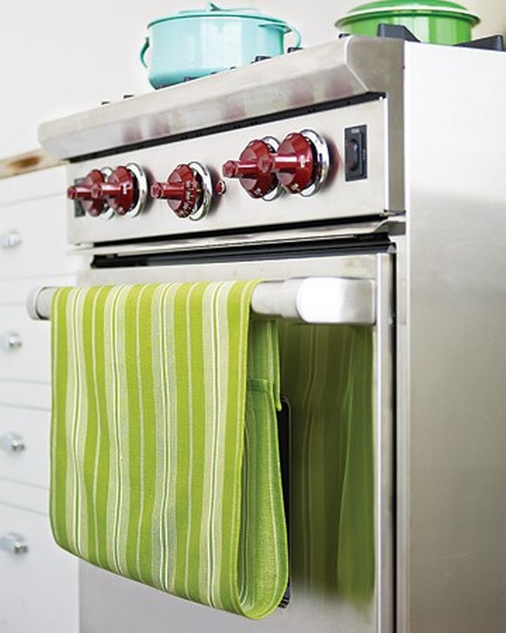 46 Useful Storage Ideas - Add a Velcro strip to your dish towels so it doesn't fall when hanging.