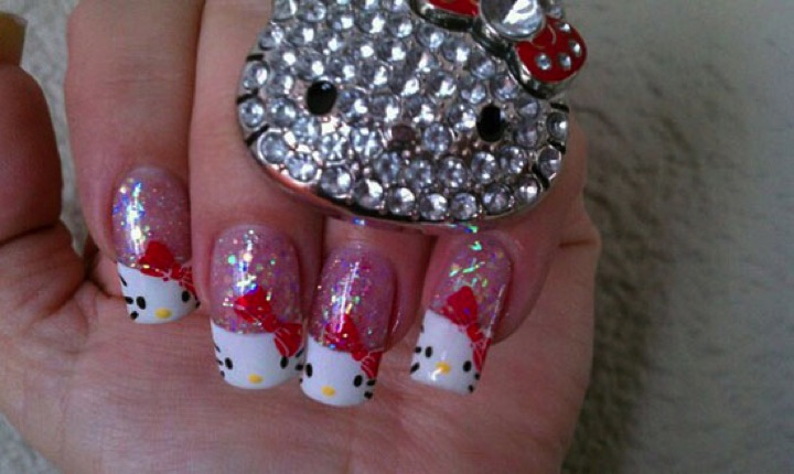 14 Hello Kitty Nails - Hello Kitty nails with some bling.