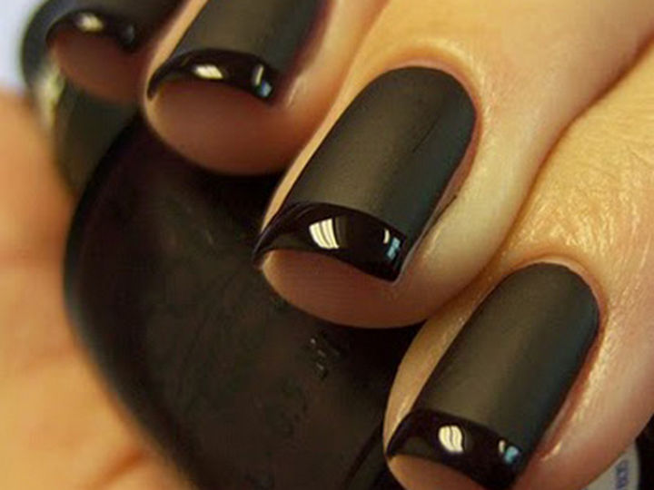 22 Black Nails That Look Edgy and Chic - A beautiful black twist on a French manicure.