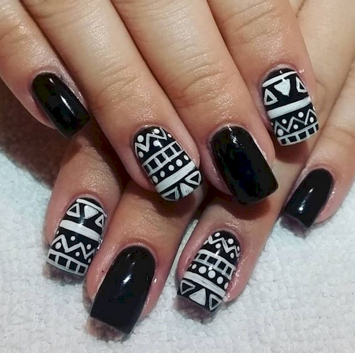 22 Black Nails That Look Edgy and Chic - White on black nail art designs.
