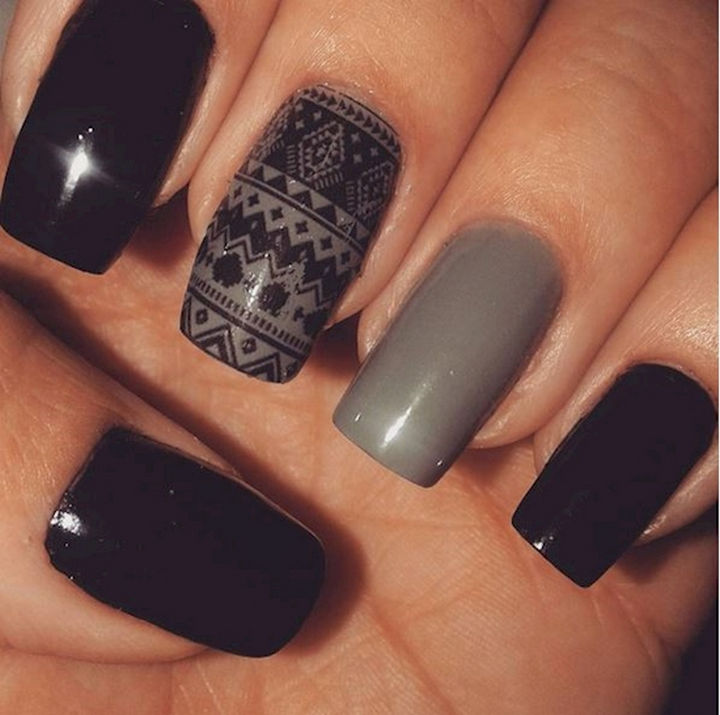 22 Black Nails That Look Edgy and Chic - Accented nails with a pixelated pattern.